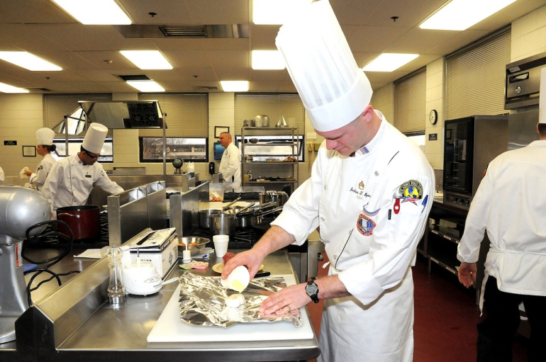 Fort Monroe's Staff Sgt. Joshua Spiess prepares a head of garlic while competing for the Senior Chef of the Year Feb. 28. Spiess was the only competitior who earned a gold medal in the event, which is judged on a point system. The Senior Chef competition was the first event in the 35th Army Culinary Arts Competition.
